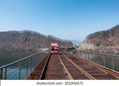 Activity trolley tram running on railway track in river
