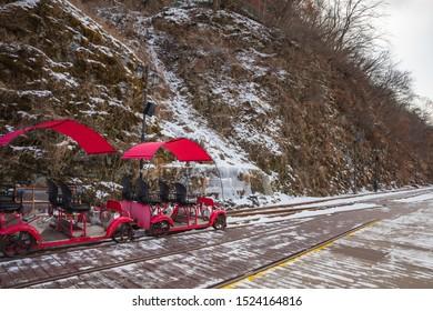 Activity trolley tram running on railway track in winter