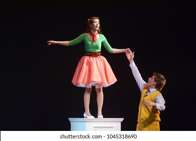 actor and actress on stage