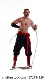 Actor Athlete man in trousers with naked torso training with chain on white background.