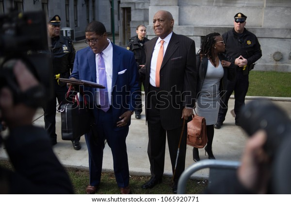 Actor Bill Cosby and spokesman Andrew Wyatt arrive for day 2 of Cosby's sexual assault re-trial at the Montgomery County Courthouse in Norristown, PA, April 10, 2018.