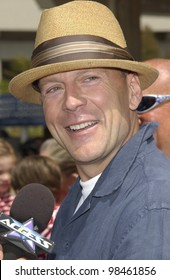 Actor BRUCE WILLIS at the Los Angeles premiere of his new movie Rugrats Go Wild. June 1, 2003