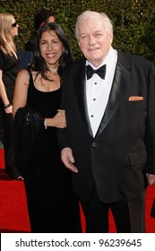 Actor CHARLES DURNING & daughter at the Creative Arts Emmy Awards in Los Angeles. September 11, 2005; Los Angeles, CA:    Paul Smith / Featureflash