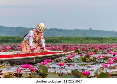 Actor dress-up and performing of Khon, Thai traditional dancing, on the boat in pink lotus field, Thale Noi lagoon in Phatthalung Thailand.