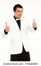 Actor enjoying his success. Happy clerk giving thumbs-up. Young excited man on white background.