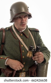 Actor in the form of a German infantryman from the times of the First World War Posing on white background