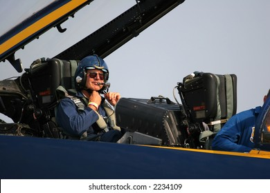 Actor Harrison Ford getting out of a Blue Angel jet at the 2006 Air Venture airshow in Wisconsin.