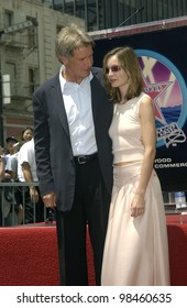 Actor HARRISON FORD & girlfriend actress CALISTA FLOCKHART on Hollywood Boulevard where he was honored with the 2,226th star on the Hollywood Walk of Fame. 30MAY2003