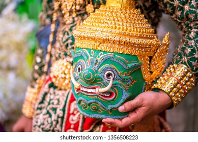 The actor holding kind of Thai drama Tossakan giant mask.  Khon is a noble Thai art of elegance. Elegant and delicate One type of dance performance based on drama.