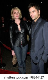 Actor JOHN STAMOS & model wife REBECCA ROMIJN STAMOS at the Los Angeles premiere of Snatch. 18JAN2001.   Paul Smith/Featureflash