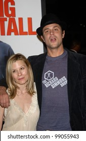 Actor JOHNNY KNOXVILLE & wife at the world premiere, in Hollywood, of his new movie Walking Tall. March 29, 2004