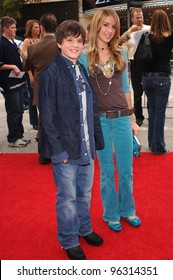 Actor JOSH HUTCHERSON & girlfriend at the Los Angeles premiere of his new movie Zathura. November 6, 2005  Los Angeles, CA.  2005 Paul Smith / Featureflash
