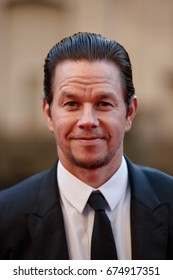 Actor Mark Wahlberg arrives on the red carpet at the Transformers The Last Knight movie premiere on June 20, 2017 in Chicago.