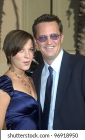 Actor MATTHEW PERRY & girlfriend RACHEL DUNN at the 2004 Primetime Creative Arts Emmy Awards at the Shrine Auditorium, Los Angeles. September 12, 2004