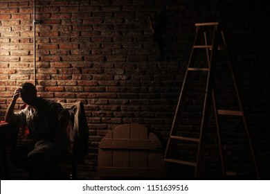 Actor on the set with bricks and a ladder