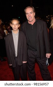 Actor POWERS BOOTHE & son at the Los Angeles premiere of Joe Somebody. 19DEC2001.  Paul Smith/Featureflash