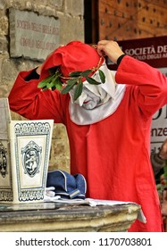 Actor prepares for a performance as Dante Alighieri, who reads Divine Comedy near a Dante's museum. It was the most important poem of Middle Ages. Italy, Florence – April 17, 2018