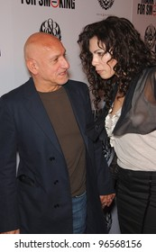 """Actor Sir BEN KINGSLEY & date at the Los Angeles premiere of """"Thank You For Smoking"""". March 16, 2006  Los Angeles, CA  2006 Paul Smith / Featureflash"""