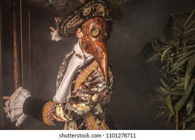 Actor in steam punk masks and antique costumes indoor.