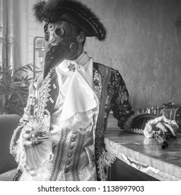 Actor in steam punk masks and antique costumes black-white art photo.