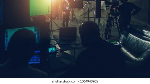 actor in studio posing on green screen - Shutterstock ID 1064943905