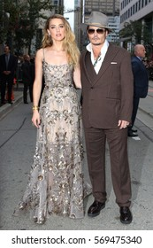 Actors Amber Heard and Johnny Depp attend 'The Danish Girl' premiere during the 2015 Toronto International Film Festival held at the Princess of Wales Theatre on September 12, 2015 in Toronto, Canada.