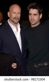 Actors BRUCE WILLIS (left) & COLIN FARRELL at the world premiere, in Los Angeles, of their new movie Hart's War. 12FEB2002.  Paul Smith/Featureflash