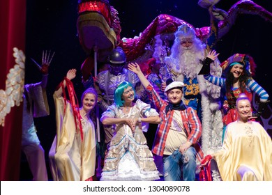 Actors play a performance for children on stage.
