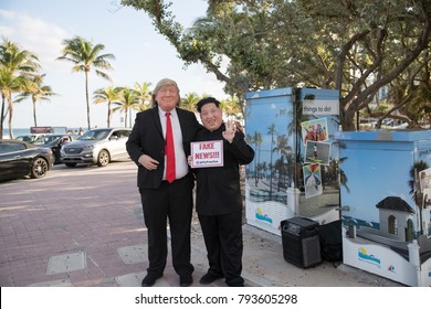 "Actors playing Donald Trump and Kim Jong-Un hold ""Fake News"" poster. Fort Lauderdale Beach, FL, USA. January 13, 2018."