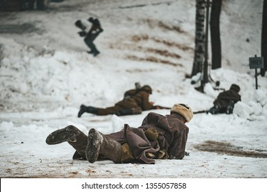 actors re-enactors at the historic festival staged a battle of the second world war, the soldiers of the red army in greatcoats lay on the snow, firing from the enemy and holding the defense