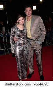 Actress AMBER BENSON & actor boyfriend ANDY HALLERT at the Hollywood premiere of Valentine. 01FEB2001.   Paul Smith/Featureflash