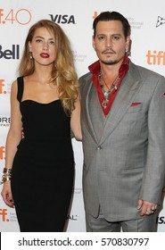Actress Amber Heard (L) and actor Johnny Depp attend the 'Black Mass' premiere during the 2015 Toronto International Film Festival at The Elgin on September 14, 2015 in Toronto, Canada.