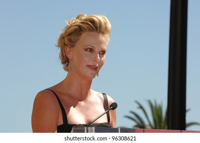 Actress CHARLIZE THERON on Hollywood Boulevard where she was honored with the 2,291st star on the Hollywood Walk of Fame. September 29, 2005  Los Angeles, CA.  2005 Paul Smith / Featureflash