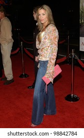 Actress CHRISTINA COX at the world premiere, in Hollywood, of Along Came Polly. January 12, 2004
