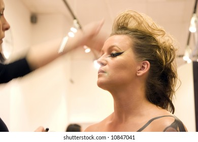 Actress getting make-up before performance