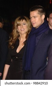Actress JENNIFER ANISTON & husband actor BRAD PITT at the world premiere, in Hollywood, of her new movie Along Came Polly. January 12, 2004