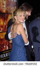 Actress KATE HUDSON & husband CHRIS ROBINSON at the world premiere, in Los Angeles, of her new movie The Four Feathers. 17SEP2002.   Paul Smith / Featureflash
