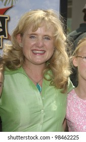 Actress NANCY CARTWRIGHT & family at the Los Angeles premiere of her new movie Rugrats Go Wild. June 1, 2003