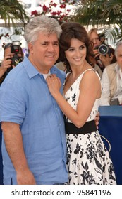 "Actress PENELOPE CRUZ and director PEDRO ALMODOVAR at photocall for ""Volver"" at the 59th Annual International Film Festival de Cannes. May 17, 2006  Cannes, France.  2006 Paul Smith / Featureflash"