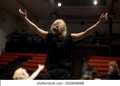 actress rehearsing in front of empty theater