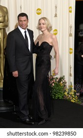 Actress SHARON STONE & actor JOHN TRAVOLTA at the 74th Annual Academy Awards in Hollywood. 24MARR2002.   Paul Smith / Featureflash
