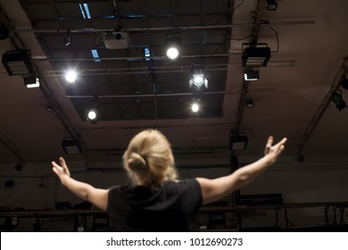 actress singing and acting in theater play
