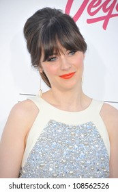 Actress Zooey Deschanel arrives at the 2012 Billboard Music Awards held at the MGM Grand Garden Arena.