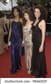 Actresses ANDIE MacDOWELL (in black) & LAETITIA CASTA & NOEMIE LENOIR (in blue) at the screening of The Matrix Reloaded at the Cannes Film Festival. 15MAY2003