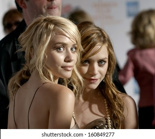 Actresses Mary Kate and Ashley Olsen attend the premiere of NEW YORK MINUTE at the Tribeca Performing Arts Center on May 4, 2004 during the Tribeca Film Festival in New York
