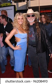 Actress/pop star JESSICA SIMPSON  & actor WILLIE NELSON at the Los Angeles premiere of their new movie The Dukes of Hazzard. July 28, 2005 Los Angeles, CA  2005 Paul Smith / Featureflash