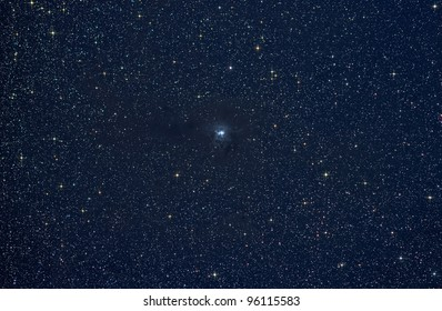 Actual astrophotograph.  Iris Nebula.  Hard processed - stars color intensified and diffraction spikes added.  Great science background.  Zoom in for best view.