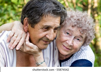 actual gladness of elderly people hugging