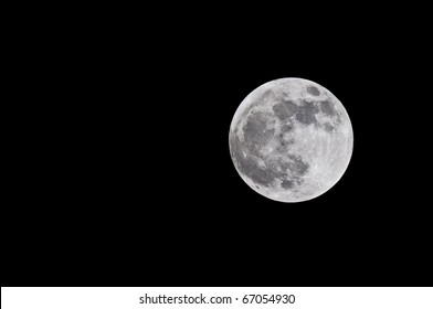 Actual high resolution photograph of full moon against a black sky with room for your text