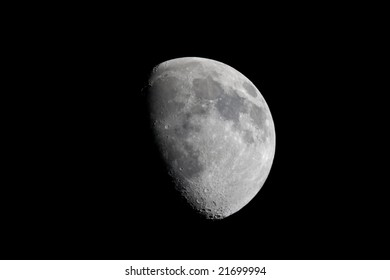 Actual photographic view of the waxing gibbous moon taken at prime focus (telescope mirror is the lens) through an 8 inch Newtonian reflector telescope.  Natural isolation against a black sky.